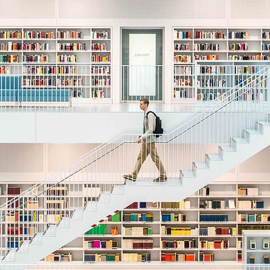A man walking in a library.